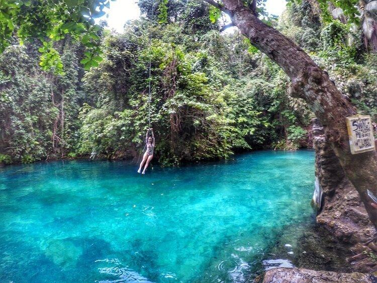 Canyoneering and swinging from a tree in Philippines at Kawasan Falls