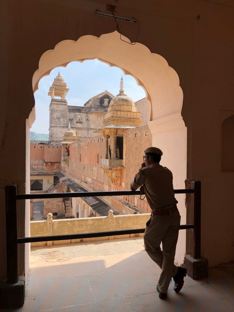 India photo tour including this photo of a man looking out a window at the Amber Fort