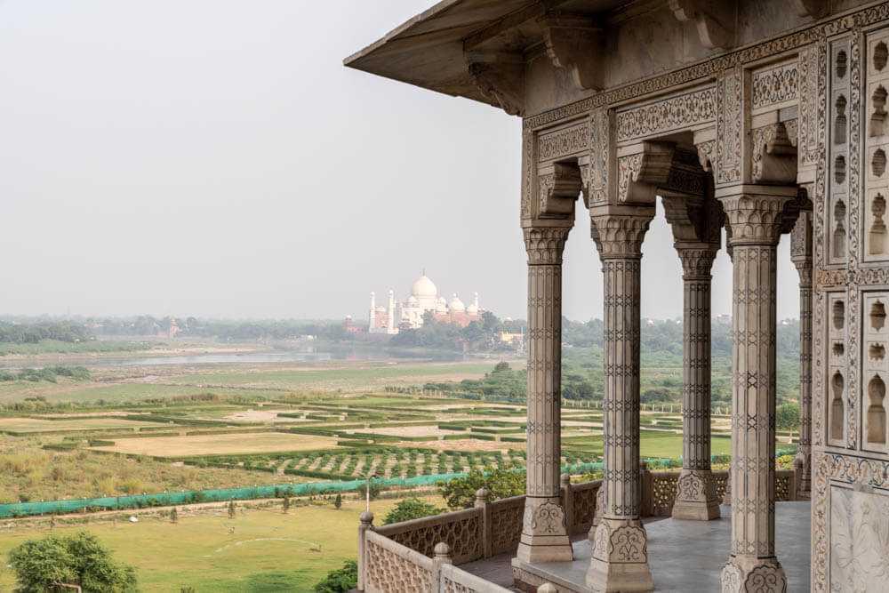 Instagram worthy photo of a Taj Mahal view from Agra fort.